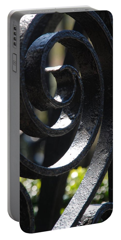 Iron Fence Portable Battery Charger featuring the photograph View Through The Iron Fence by Susanne Van Hulst