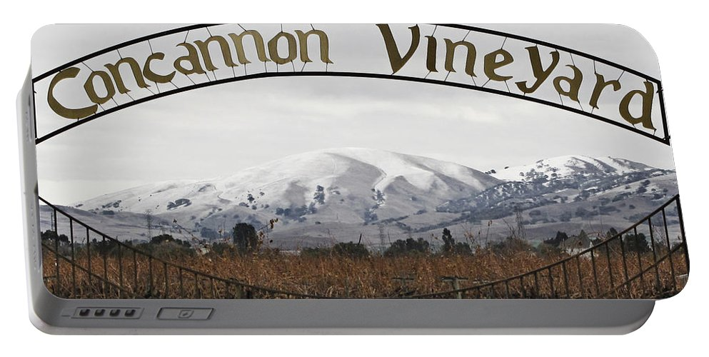 Landscape Portable Battery Charger featuring the photograph Vineyard Under Snow by Karen W Meyer