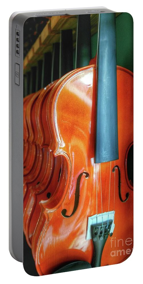Violins Hanging In A Row Portable Battery Charger featuring the photograph Violins For Sale by John Myers