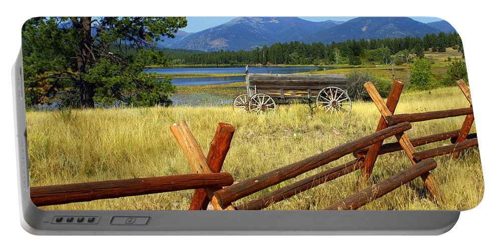 Landscape Portable Battery Charger featuring the photograph Wagon West by Marty Koch