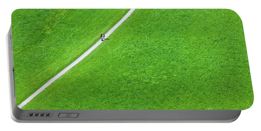 View Portable Battery Charger featuring the photograph Walking Footpath In A Green Field by Dvoevnore Photo