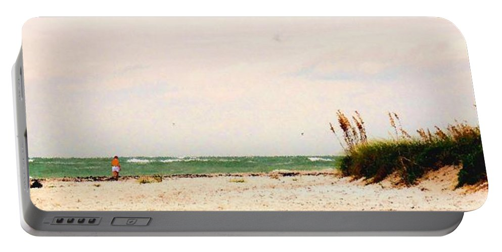 Florida Portable Battery Charger featuring the photograph Walking The Beach by Ian MacDonald
