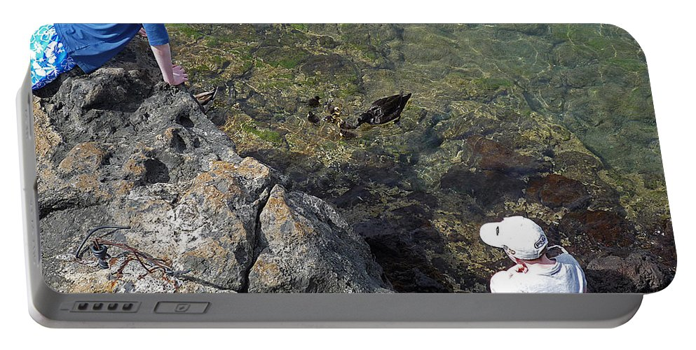 Ducks Portable Battery Charger featuring the photograph Watching The Chicks by Charles Stuart