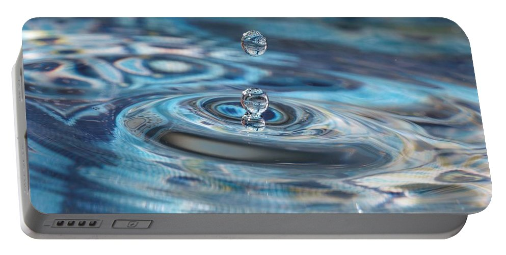 Water Drop Portable Battery Charger featuring the photograph Water Sculpture In Blue 1 by Kristina Jones