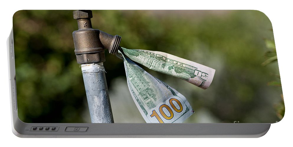 Water Cost Portable Battery Charger featuring the photograph Water Spigot With Money Flowing Out by William H. Mullins