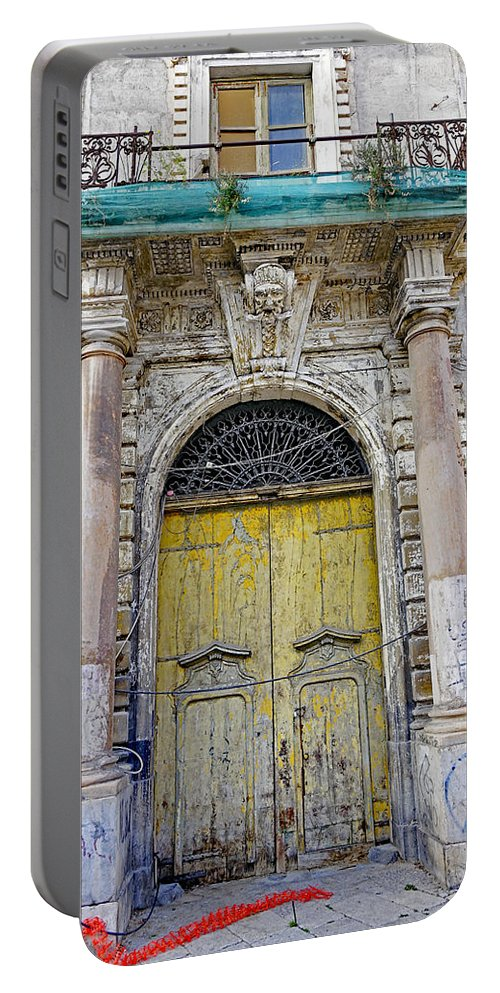 Palermo Portable Battery Charger featuring the photograph Weathered Old Artistic Door On A Building In Palermo Sicily by Richard Rosenshein