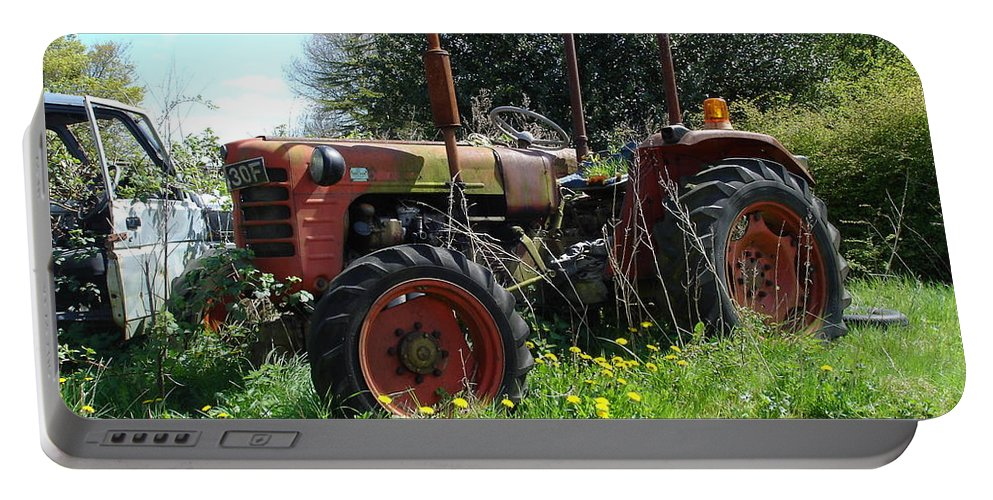 Tractor Portable Battery Charger featuring the photograph Well And Truely Retired by Susan Baker