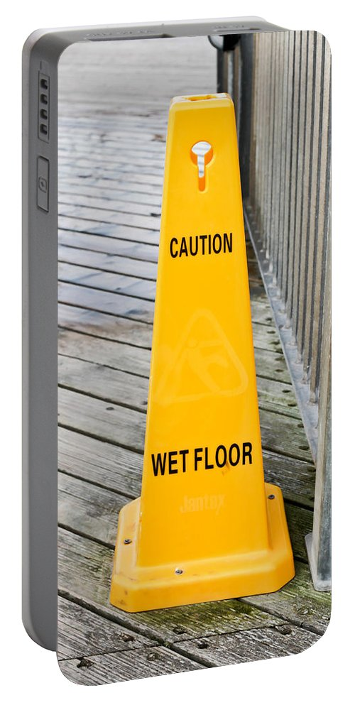 Boardwalk Portable Battery Charger featuring the photograph Wet Floor Warning by Tom Gowanlock