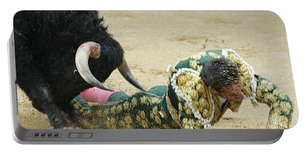 Spain Portable Battery Charger featuring the photograph When The Bull Gores The Matador II by Rafa Rivas