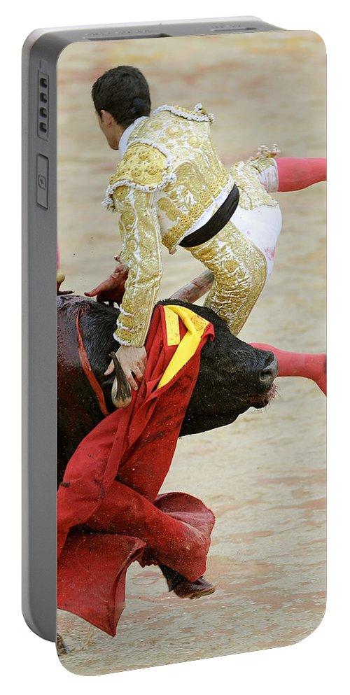 Span Portable Battery Charger featuring the photograph When The Bull Gores The Matador V by Rafa Rivas