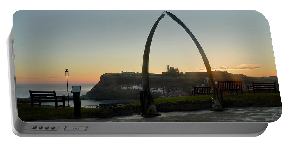 Whitby Whalebone Portable Battery Charger featuring the photograph Whitby Whalebone Golden Hour by Sarah Couzens