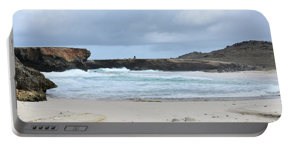 Boca Keto Portable Battery Charger featuring the photograph White Sand Beach And Large Rock Formations In Aruba by DejaVu Designs