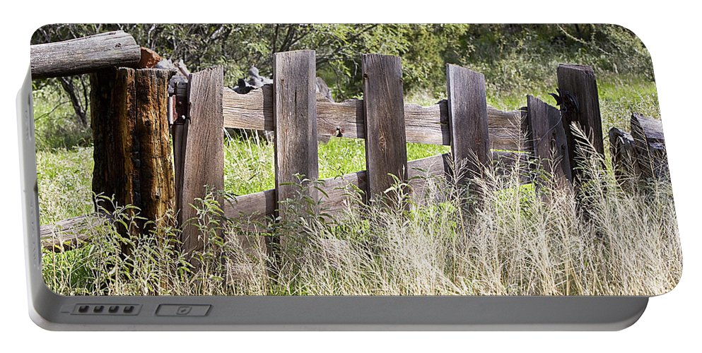 Fence Portable Battery Charger featuring the photograph Who Ate The Fence by Phyllis Denton
