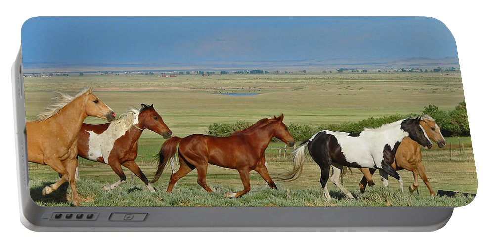 Herd Portable Battery Charger featuring the photograph Wild Horses Wyoming by Heather Coen