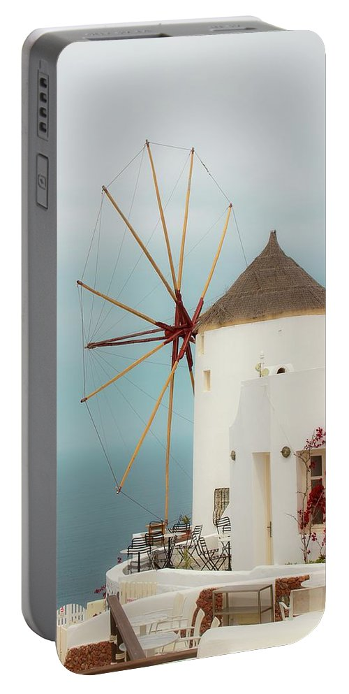 Windmill Portable Battery Charger featuring the photograph Oia Windmill by Debra Cox
