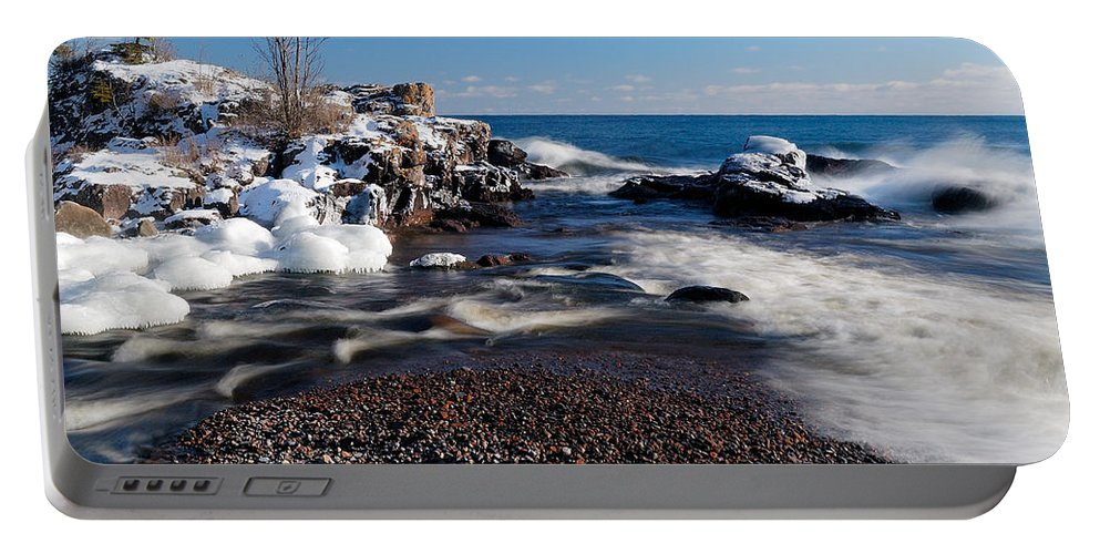 Michigan Portable Battery Charger featuring the photograph Winter Splash by Sebastian Musial