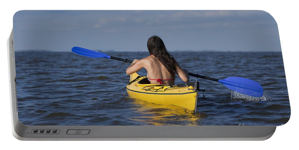 Athlete Portable Battery Charger featuring the photograph Woman Kayaking by Anthony Totah