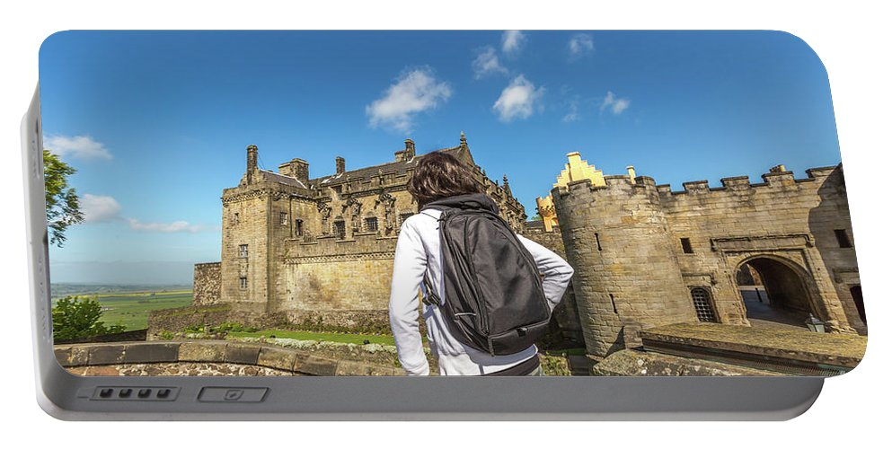 Stirling Castle Portable Battery Charger featuring the photograph Woman Looks The Stirling Castle by Benny Marty