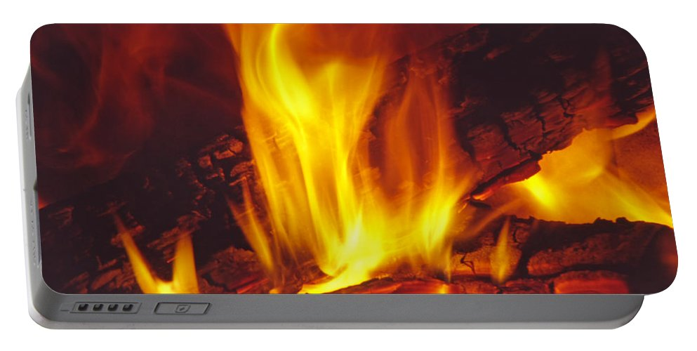 Fire Portable Battery Charger featuring the photograph Wood Stove - Blazing Log Fire by Steve Ohlsen