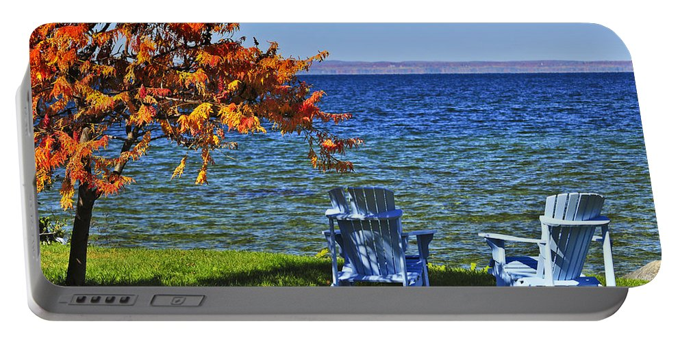 Lake Portable Battery Charger featuring the photograph Wooden Chairs On Autumn Lake by Elena Elisseeva