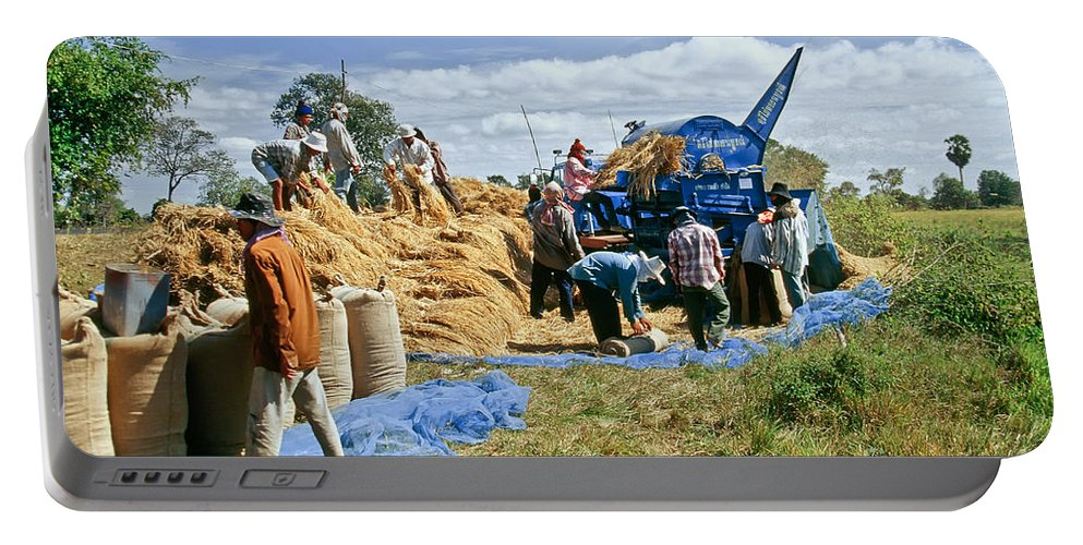 Man Portable Battery Charger featuring the photograph Workers Loading Rice by Inga Spence