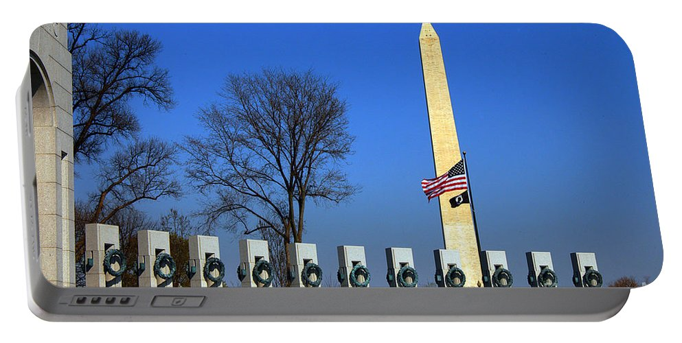 Clay Portable Battery Charger featuring the photograph World War II Memorial And Washington Monument by Clayton Bruster
