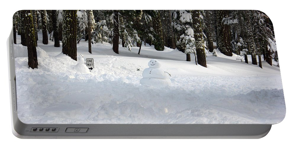 Snowman Portable Battery Charger featuring the photograph Wrong Way Snowman by Christine Jepsen