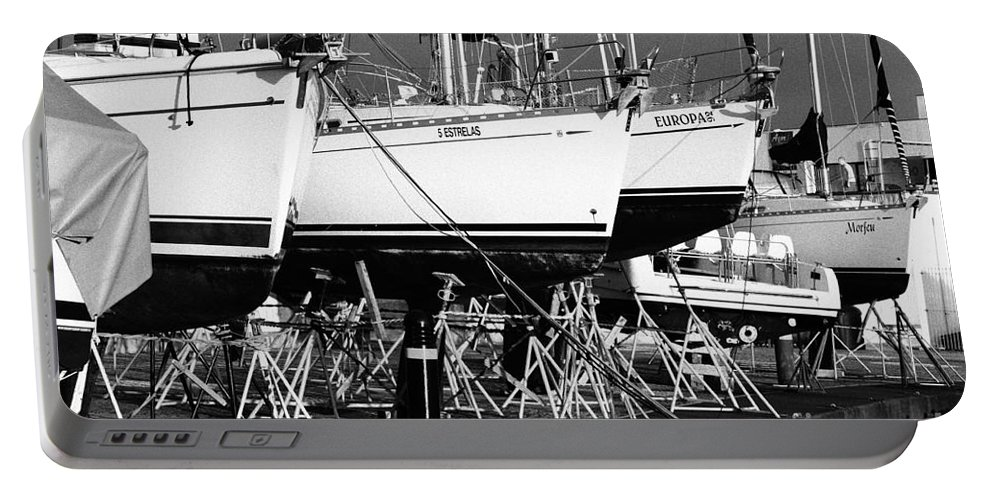 Portugal Portable Battery Charger featuring the photograph Yachts On Drydock by Gaspar Avila