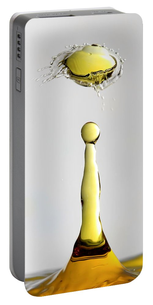 Yellow Droplet Portable Battery Charger featuring the photograph Yellow Droplet by Shannon Louder