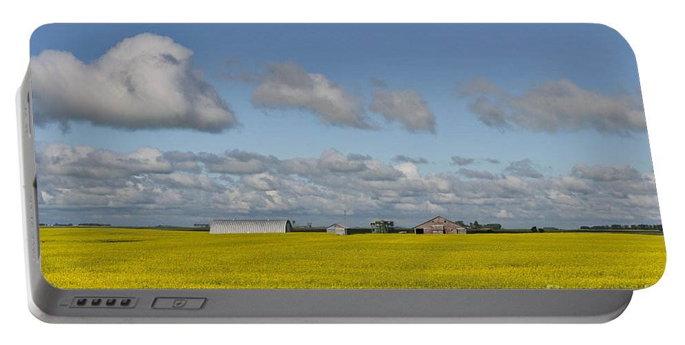 Canola Portable Battery Charger featuring the photograph Yellow Fields And Blue Clouds by David Arment