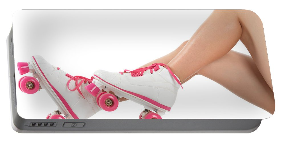 Roller Skates Portable Battery Charger featuring the photograph Young Woman Wearing Roller Derby Skates by Oleksiy Maksymenko