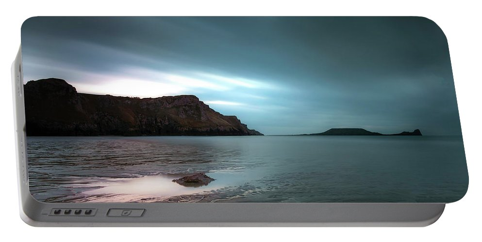 Long Exposure Portable Battery Charger featuring the photograph Rhossili Bay And Worms Head by Leighton Collins