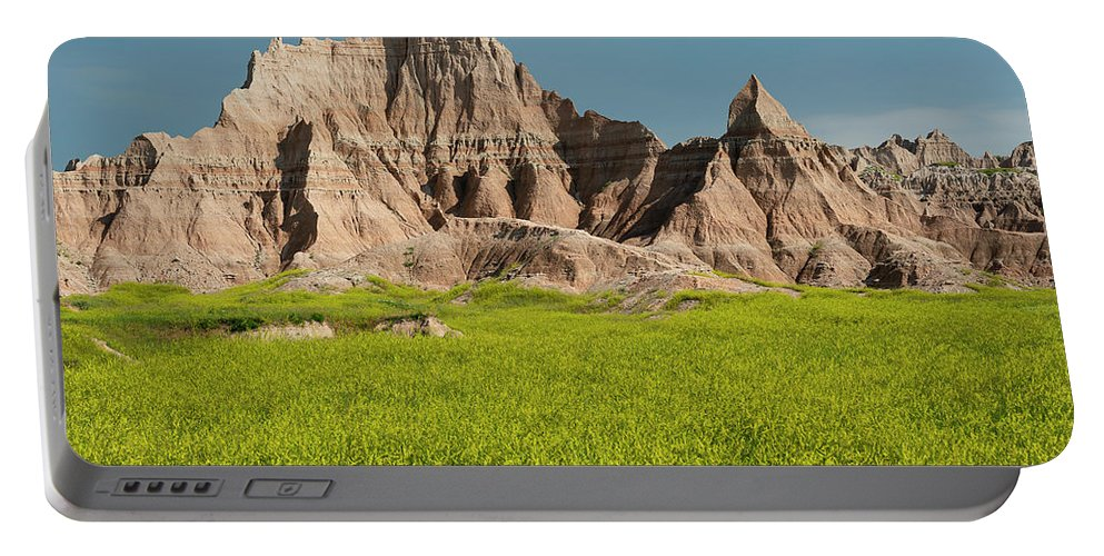 North America Portable Battery Charger featuring the photograph Badlands by Christian Heeb