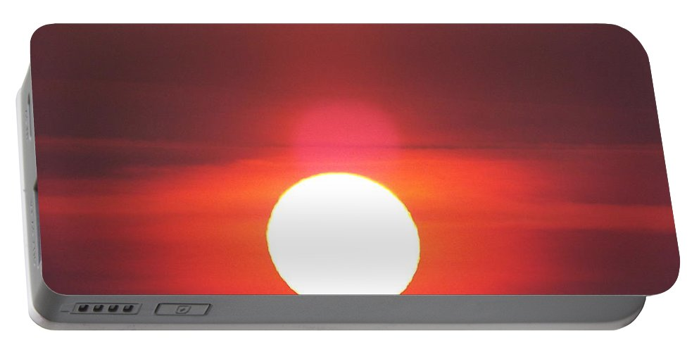 Portable Battery Charger featuring the photograph Crimson Sun by James Harris