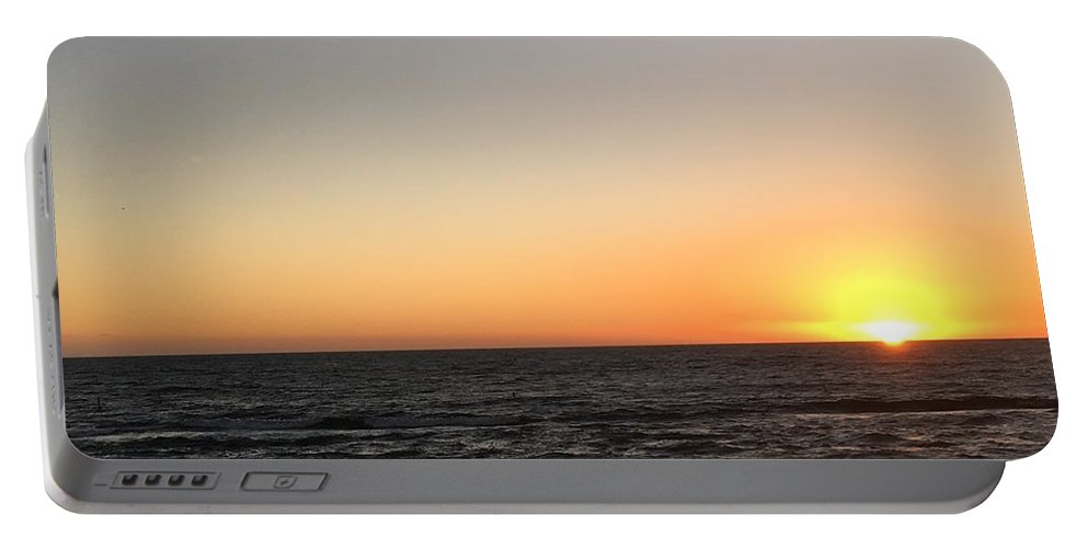 Sunset Portable Battery Charger featuring the photograph Sunset At The Sea by Epic Luis Art