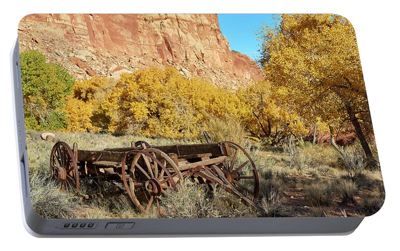 Rock Formation Portable Battery Charger featuring the photograph Vintage Wagon by Paul Freidlund