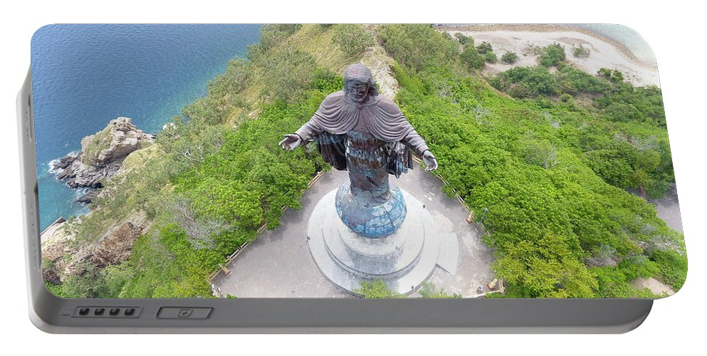 Travel Portable Battery Charger featuring the photograph Cristo Rei of Dili statue of Jesus by Brthrjhn2099