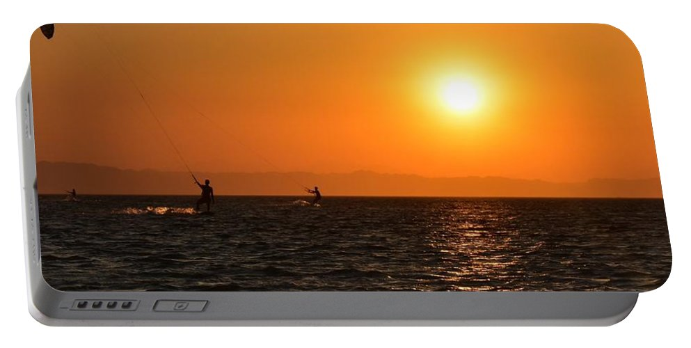 Kitesurfing Portable Battery Charger featuring the photograph Red sea sunset by Luca Lautenschlaeger