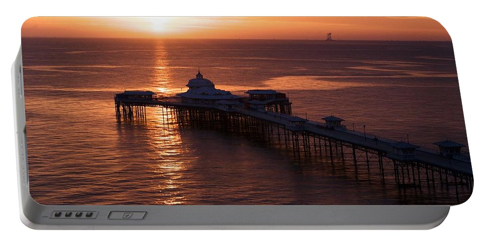 Piers Portable Battery Charger featuring the photograph Sunrise over Llandudno pier 2 by Christopher Rowlands