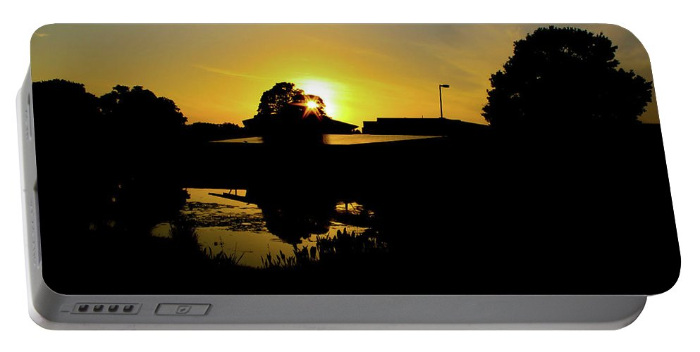 Landscape Portable Battery Charger featuring the digital art Sunset over Building by Daniel Cornell