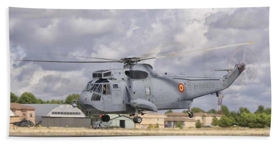 Horizontal Beach Towel featuring the photograph A Spanish Navy Sh-3d Helicopter by Giovanni Colla