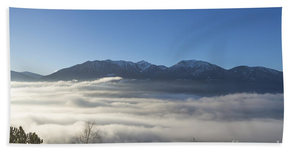 Sea Of Fog Beach Towel featuring the photograph Alpine Village Under Sea Of Fog by Mats Silvan