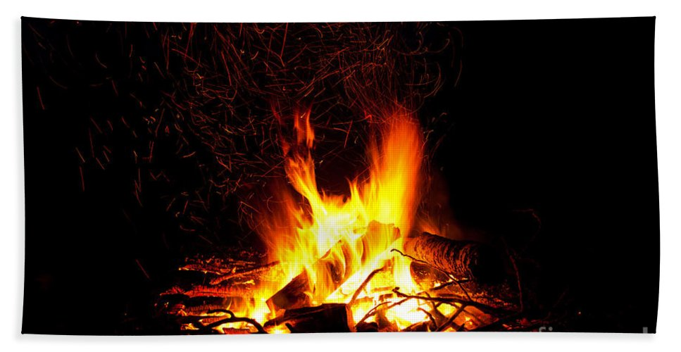 Abstract Beach Towel featuring the photograph Campfire As A Symbol Of Warmth And Life On Black by Stephan Pietzko