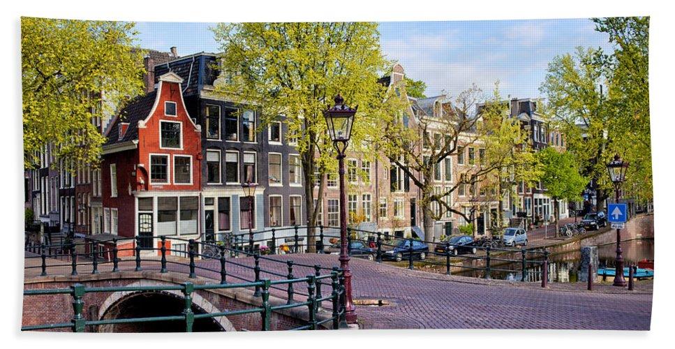 Amsterdam Beach Towel featuring the photograph Dutch Canal Houses In Amsterdam by Artur Bogacki