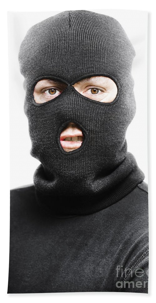 Background Beach Towel featuring the photograph Face Of A Burglar Wearing A  Ski Mask Or Balaclava 76acf208db48