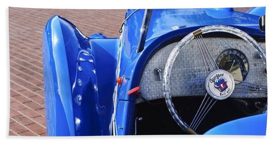 1937 Peugeot 402 Darl'mat Legere Speacial Sport Roadster Recreation Beach Towel featuring the photograph 1937 Peugeot 402 Darl'mat Legere Speacial Sport Roadster Recreation Steering Wheel Emblem by Jill Reger