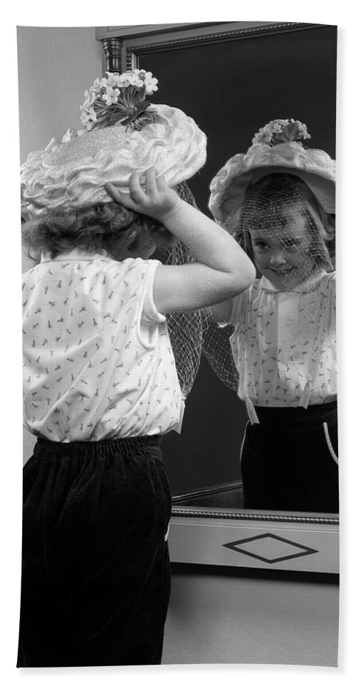Photography Beach Sheet featuring the photograph 1950s Little Girl Trying On Hat Looking by Vintage Images
