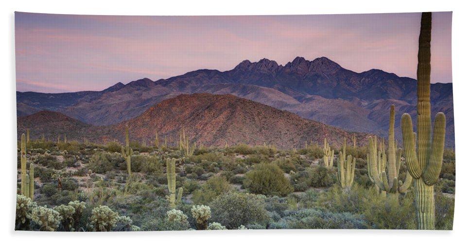 Sunset Beach Towel featuring the photograph A Desert Sunset by Saija Lehtonen
