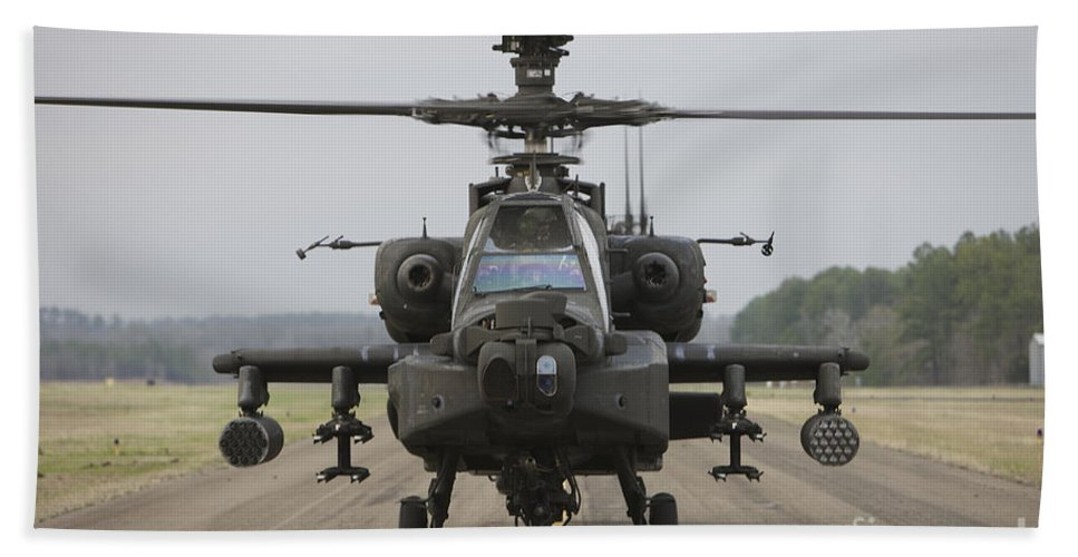 Aircraft Beach Towel featuring the photograph Ah-64 Apache Helicopter On The Runway by Terry Moore