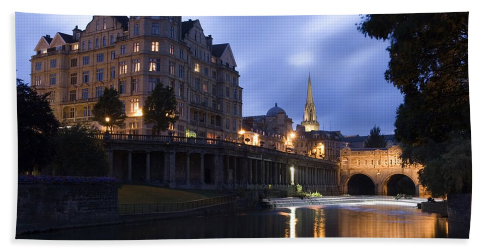 Bath Beach Towel featuring the photograph Bath City Spa Viewed Over The River Avon At Night by Mal Bray